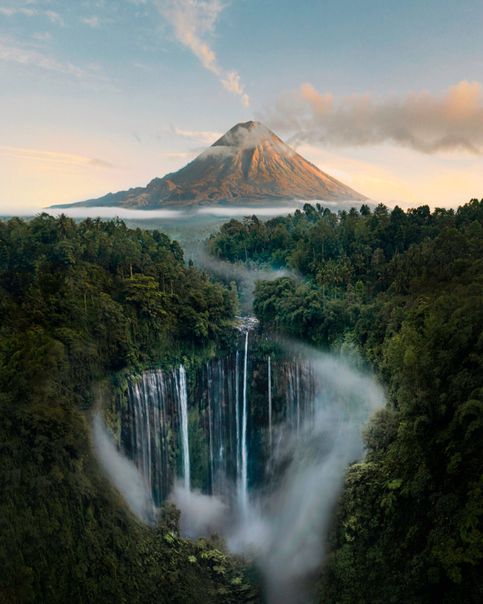 behind Tumpak Sewu there is a mountain standing proudly and symmetrically